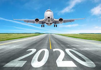 Airplane landing on runway with 2020 written on it